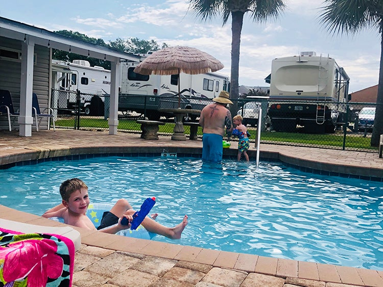 family playing in pool at emerald beach rv park florida