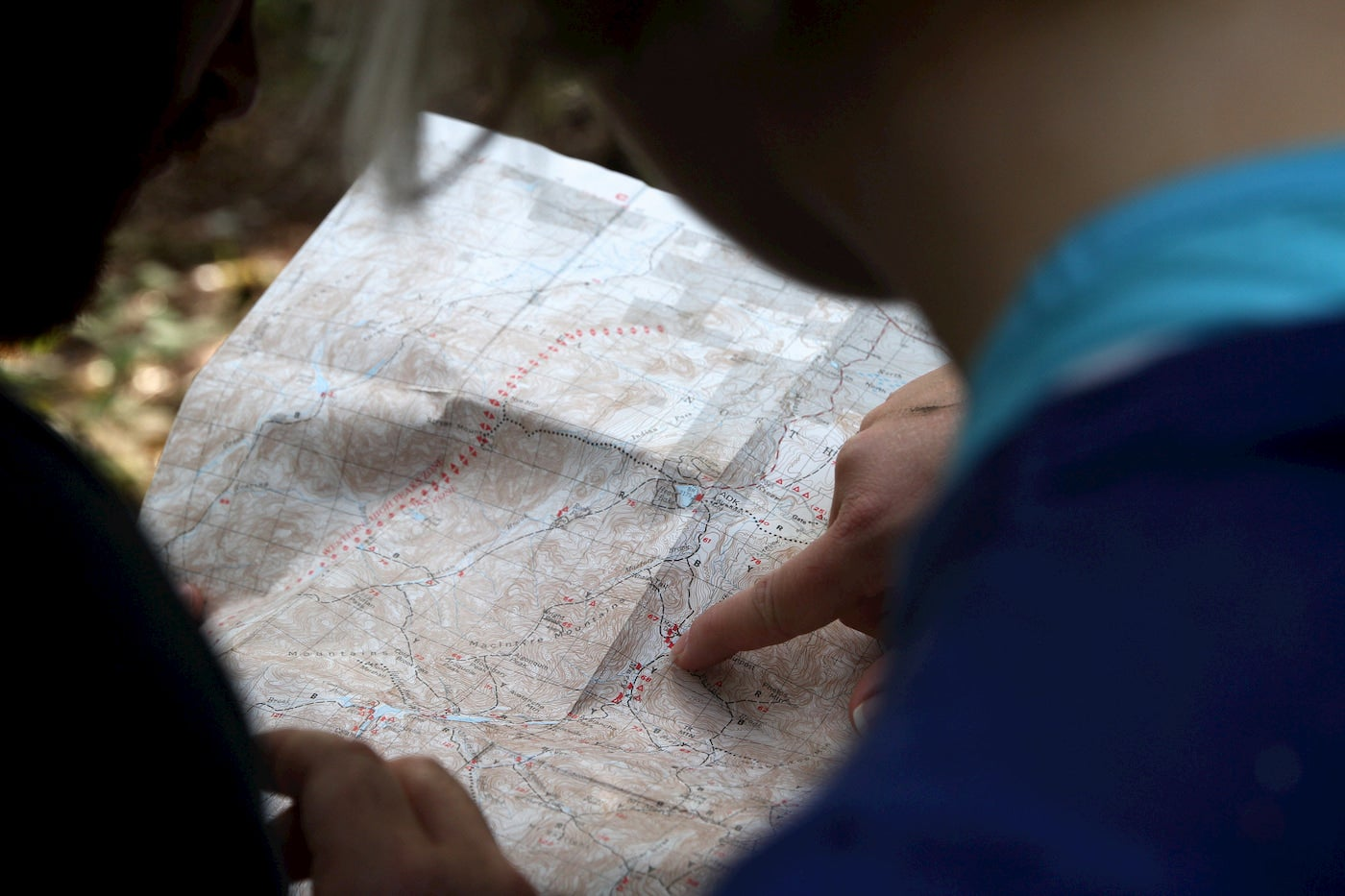 People reading a topographic map.