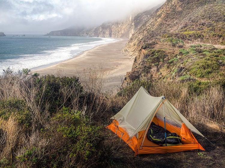 minimalist camping tent on beach