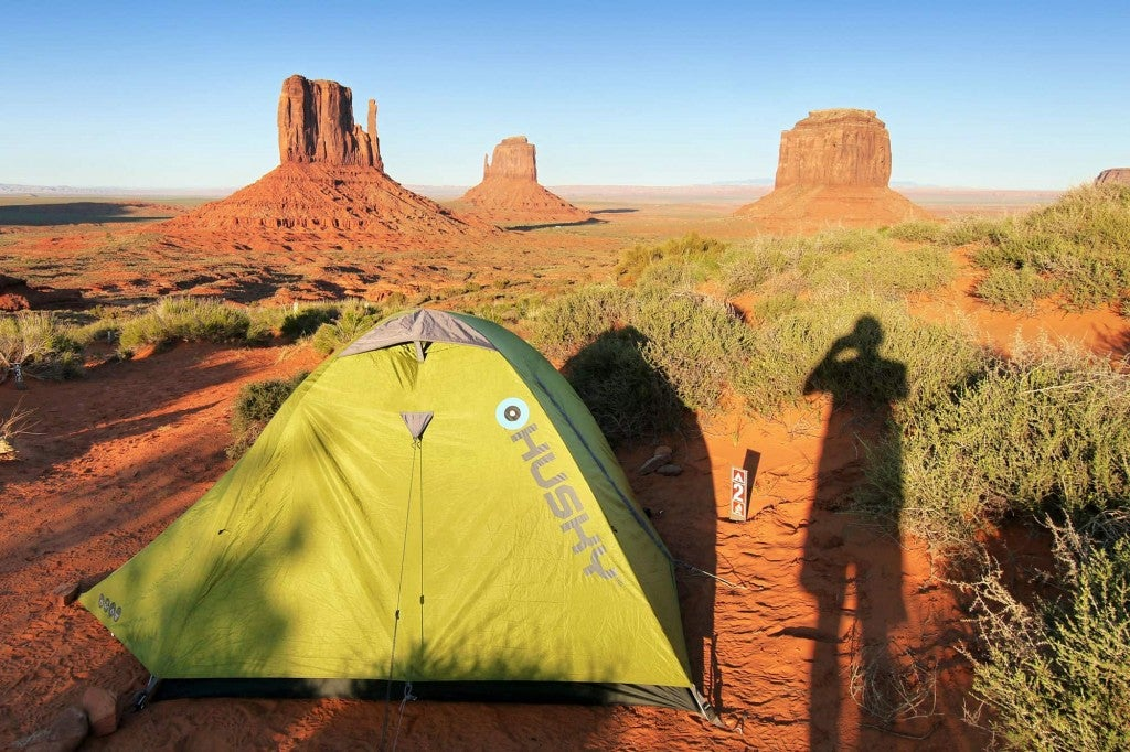 tent and shadows in monument valley