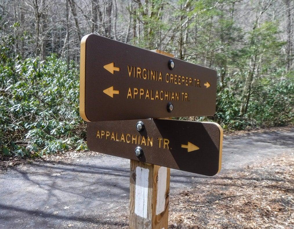 A sign on the virginia creeper trail point toward the appalachian trail