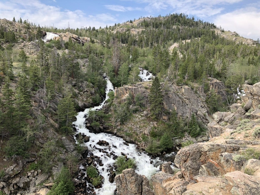 a river flowing through rocks in thethe wind river range near lander wyoming