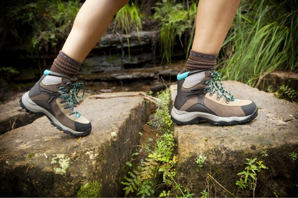hiker wearing a pair of boots on a hiking trail