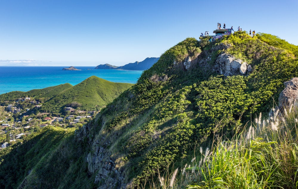 a distant view of hikers on top of pillbox hill after a hike in oahu