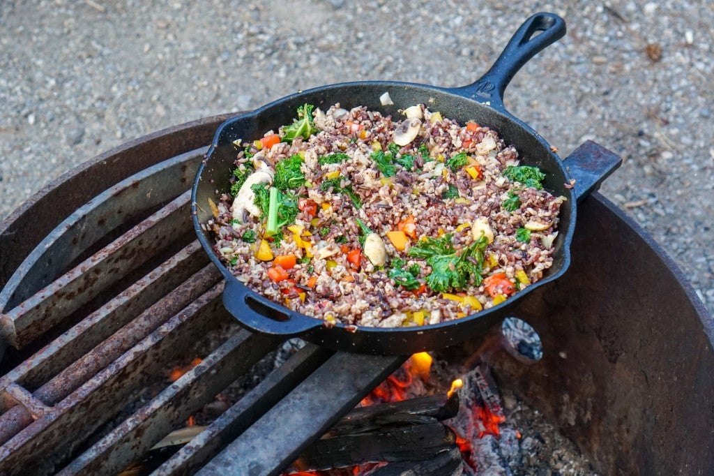 a cast iron pan full of vegetarian food