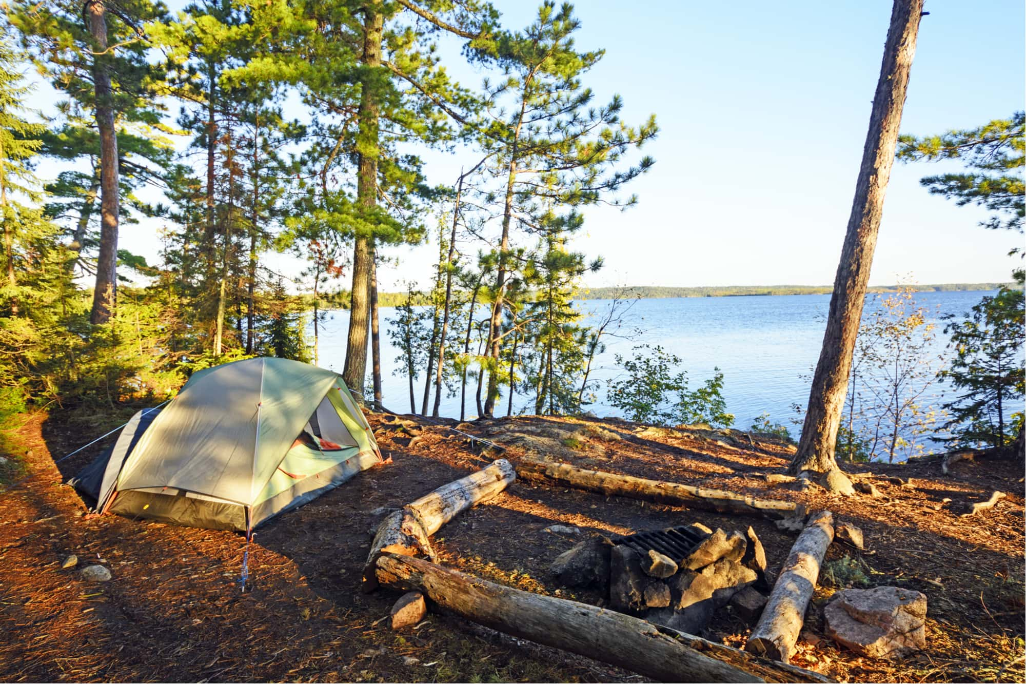 a beach campground set up near a lake in minnesota