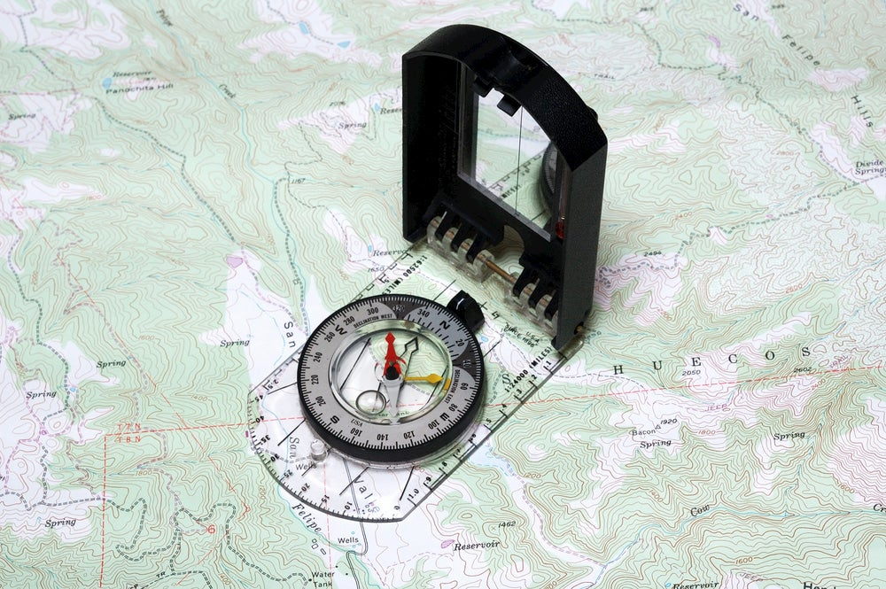 Compass on topographic map.