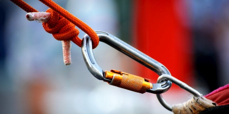 Locking carabiner between a rope and a metal loop.