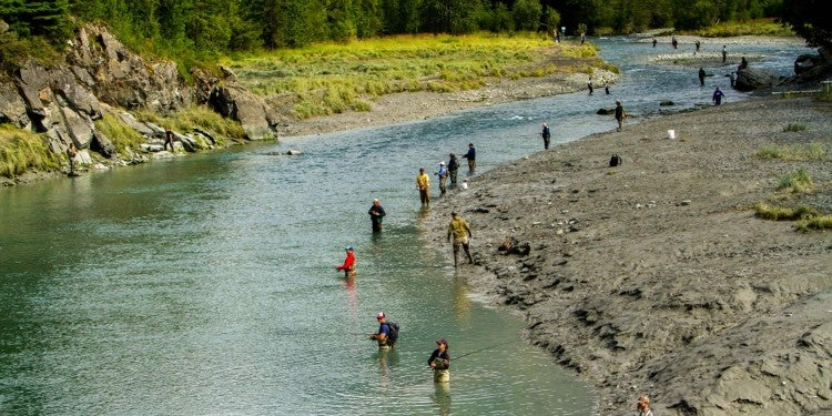 multiple people in the river on an alaska river fishing trip