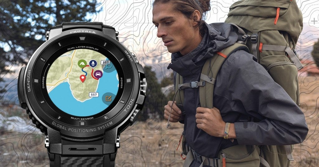 a man hiking wearing a casio maps watch