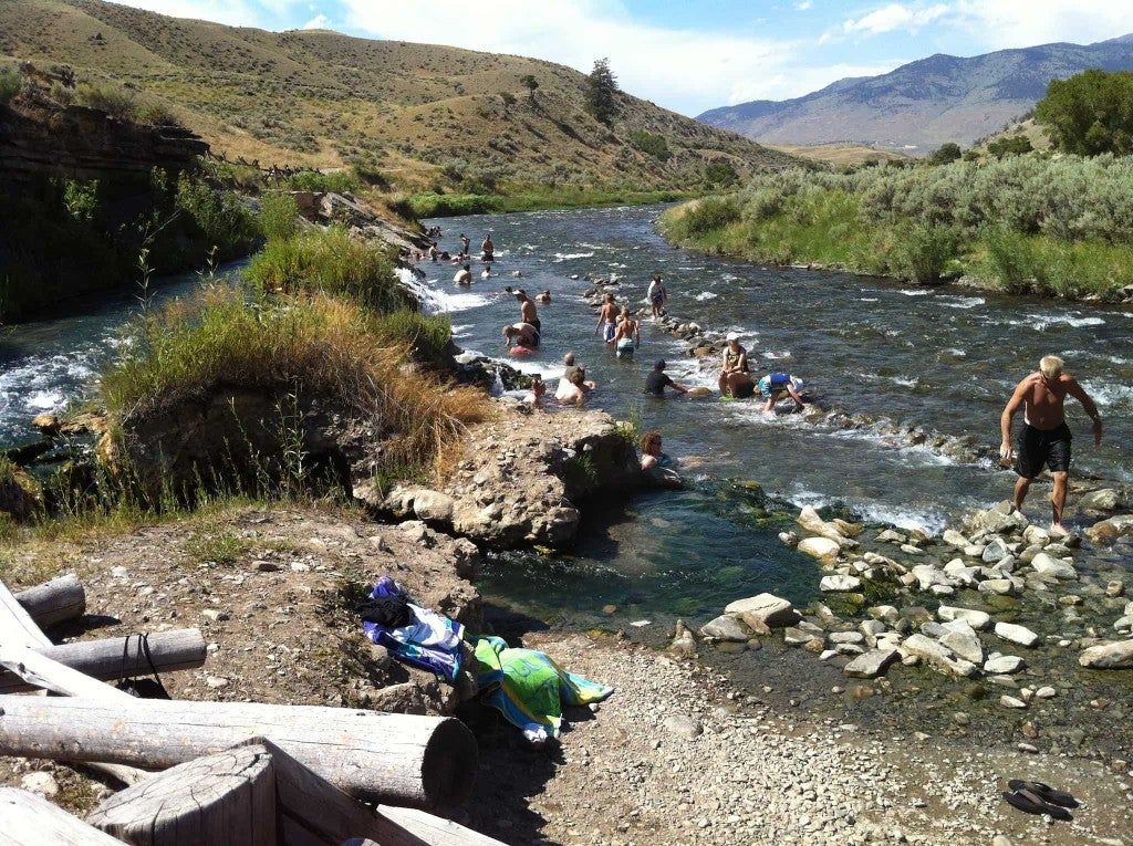 a river in wyoming with people swimming and along its banks