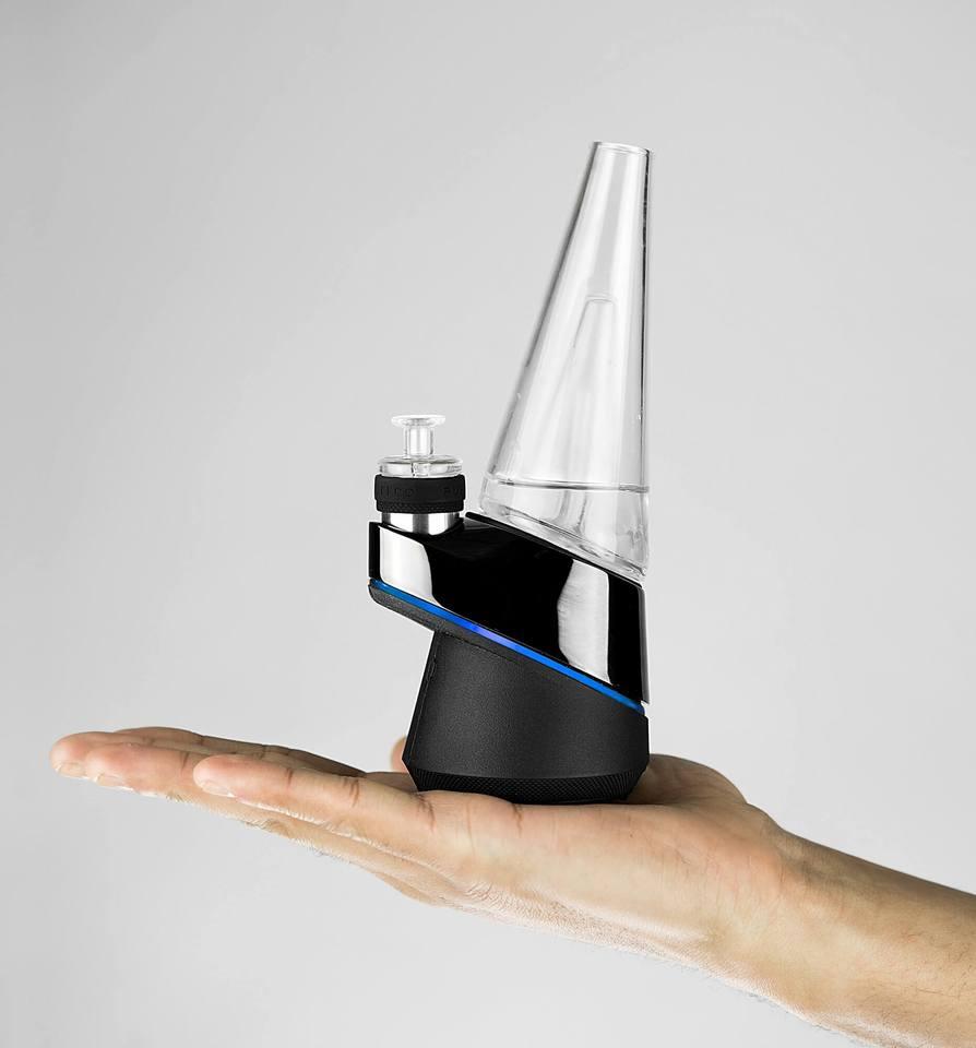 a hand holding a futuristic bong
