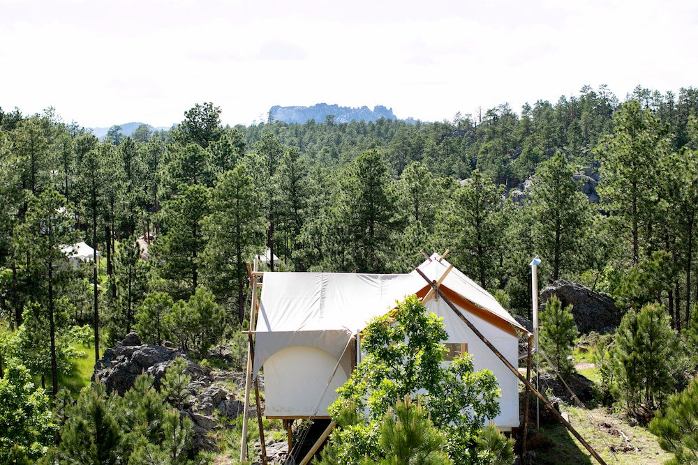 a glamping tent at under canvas with a view of mount rushmore