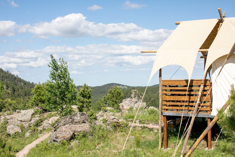 a glamping tent on stilts in the black hills of south dakota