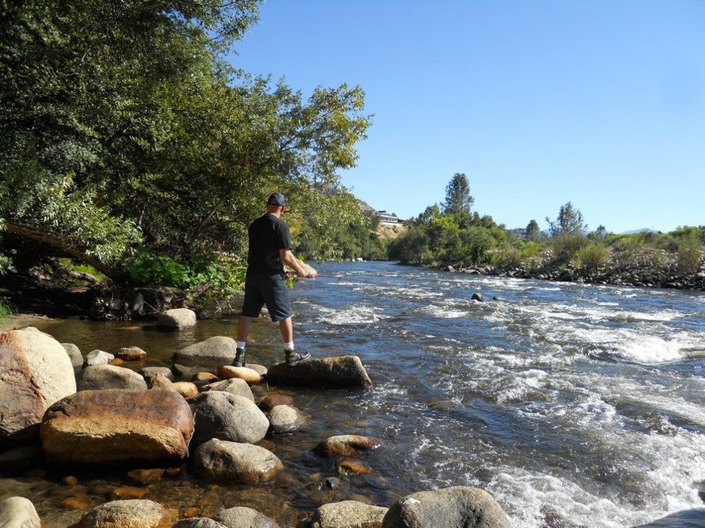 a man casting a rod into the kern river