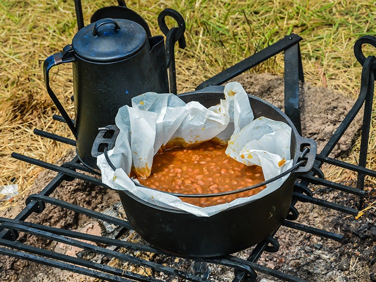 beans cooking on campfire
