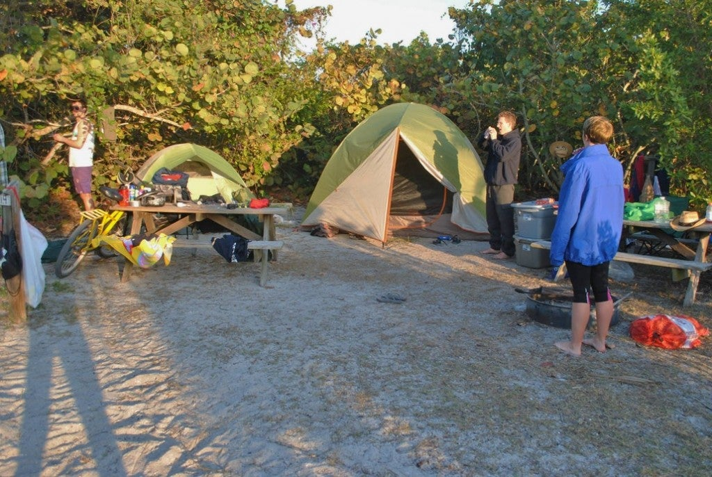 a group of people at a campsite in cayo costa florida