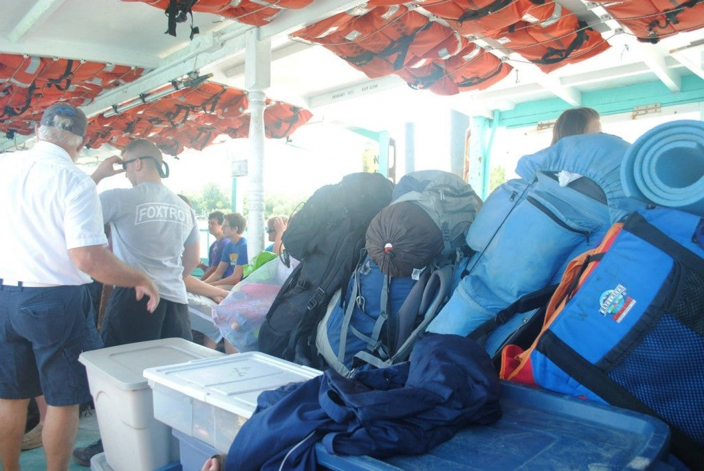backpacking and camping gear loaded up on a boat toward cayo costa