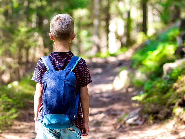 young boy on hiking trail
