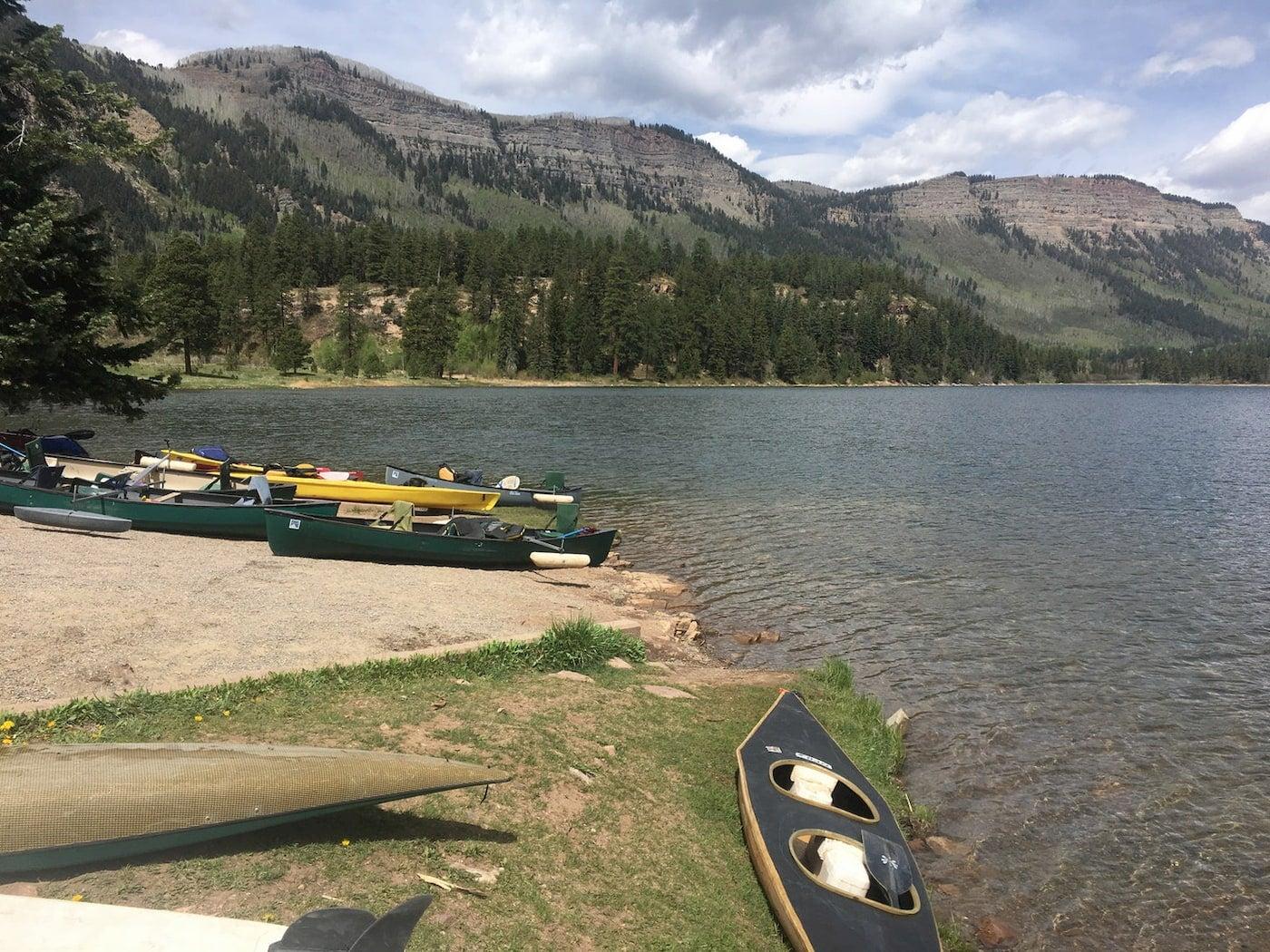 Kayaks on the banks of an alpine Haviland Lake in the San Juans.