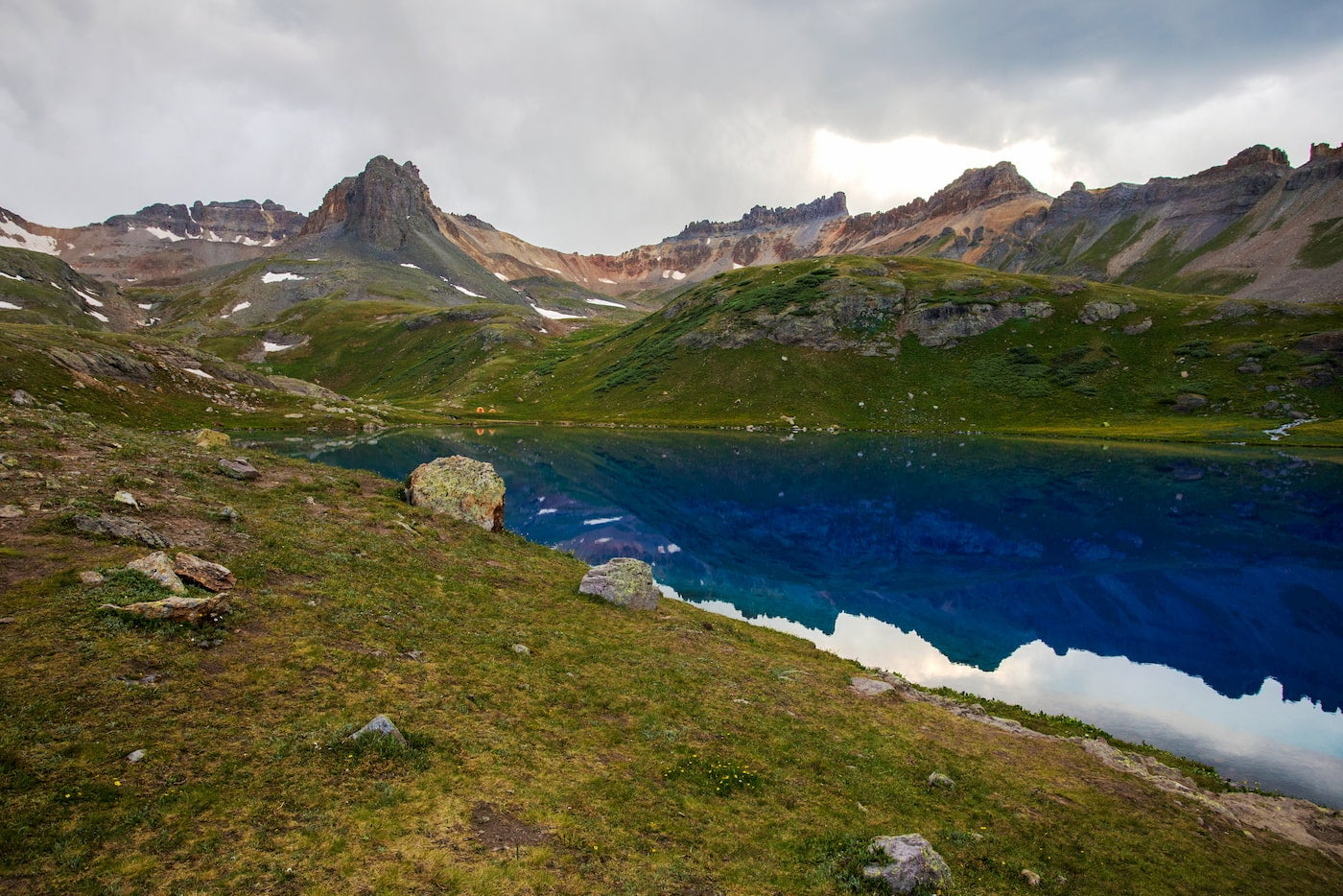 Reflection of San Juan Mountains in alpine ice lakes.