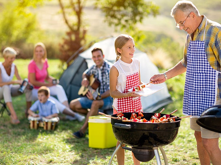 family camping with barbecue