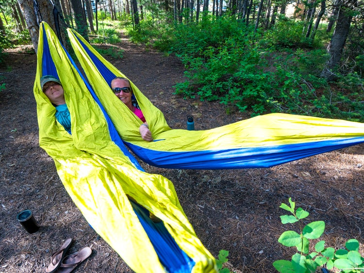two campers in hammocks