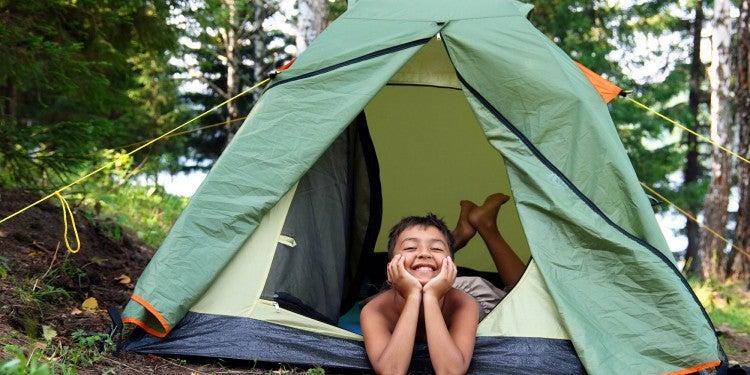 happy boy in tent
