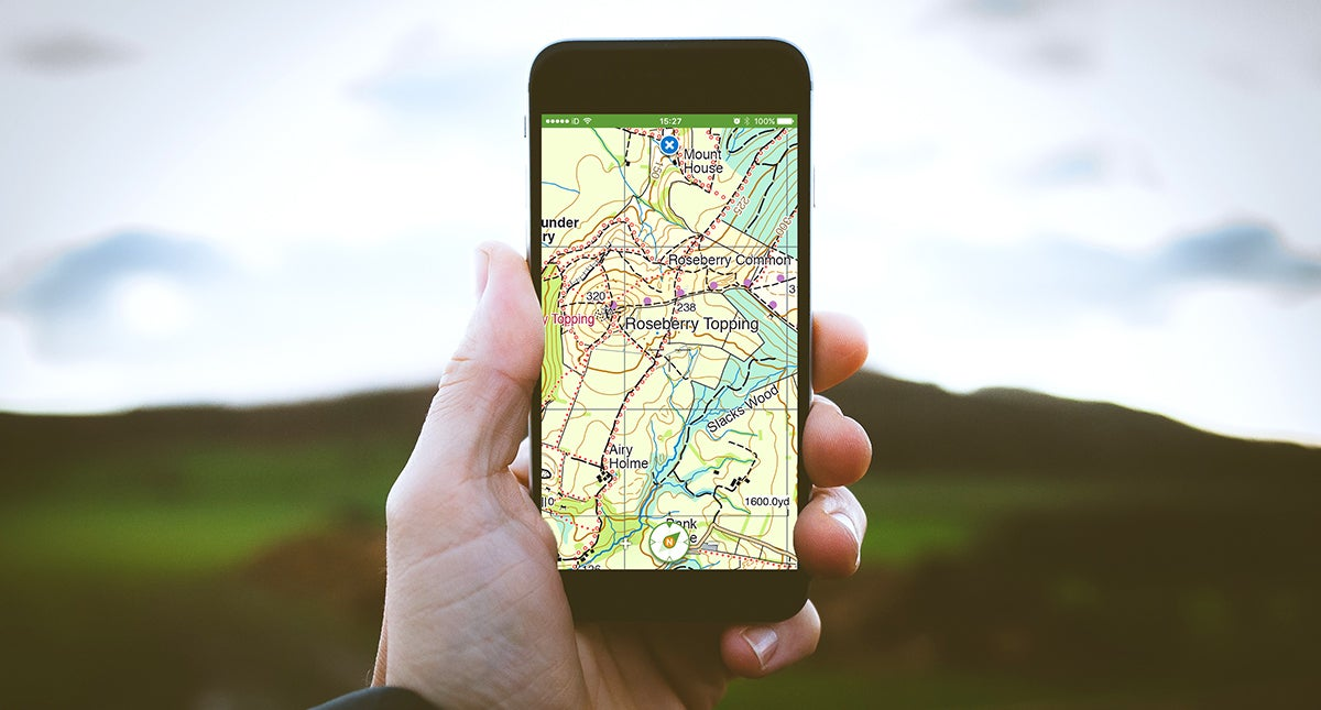 Person using viewranger on their smartphone outside.