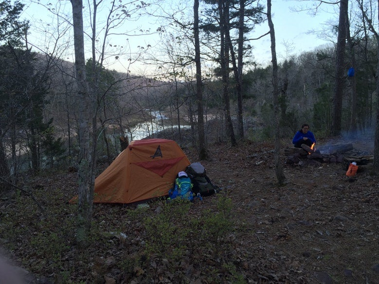 orange tent set up in woods at Missouri's Johnsons Shut Ins State Park, photo from a camper on The Dyrt