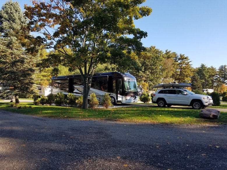 Trees surround large RV campsite at Normandy Farms in Massachusetts, photo from a camper on The Dyrt