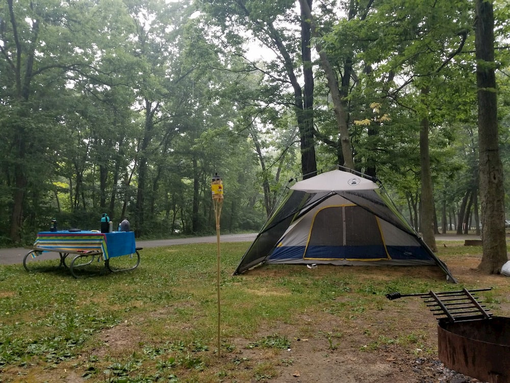 Tent at campground with trees in background