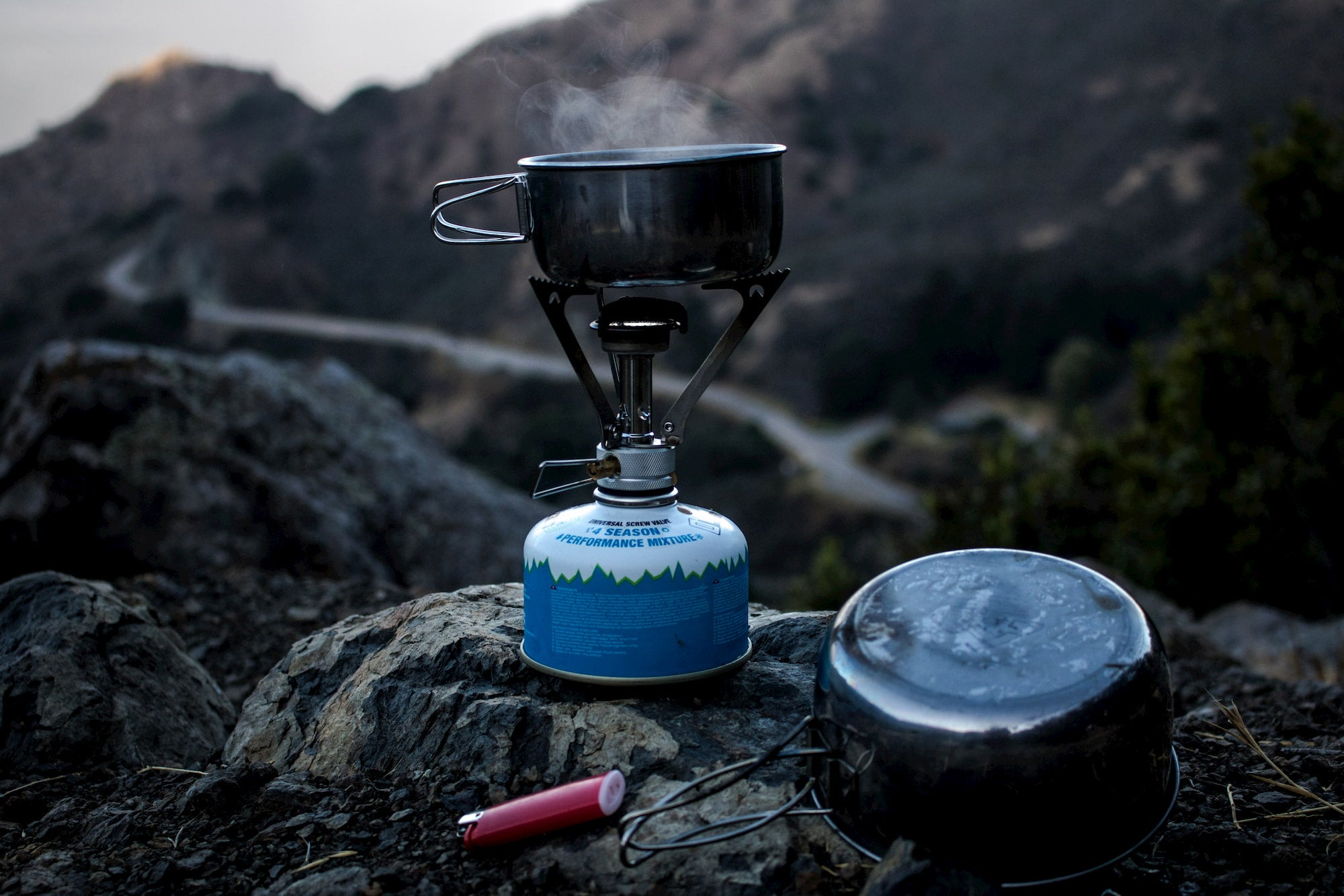 Water boiling in a backcountry camp stove.
