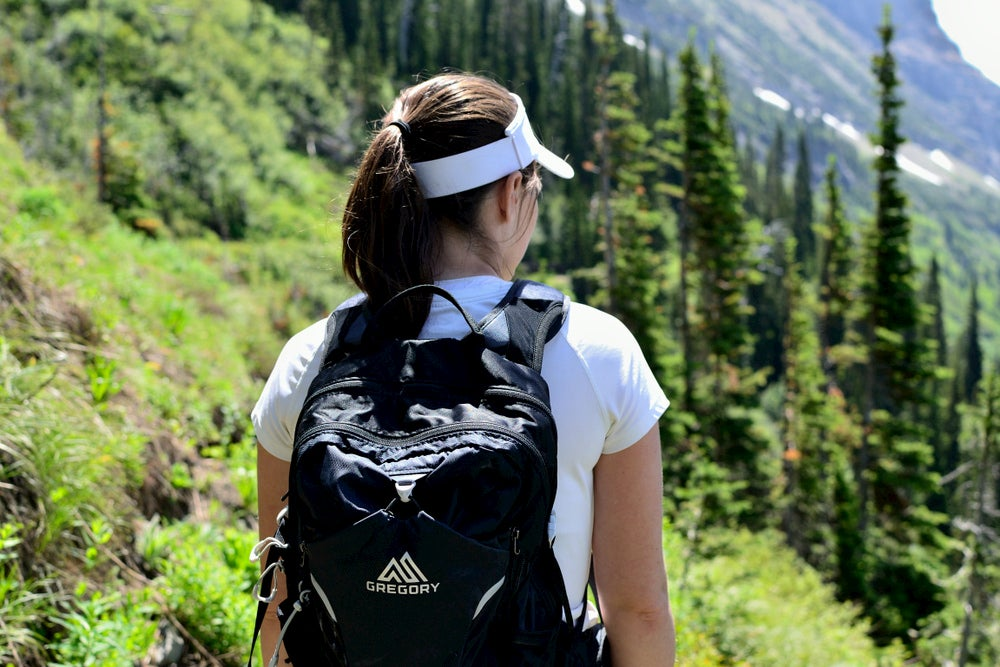 Women carrying day pack on the trail.