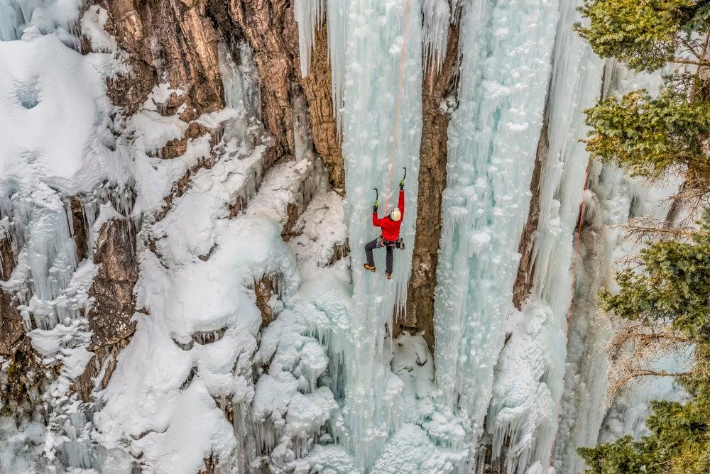 Ice climber scaling a frozen waterfall.