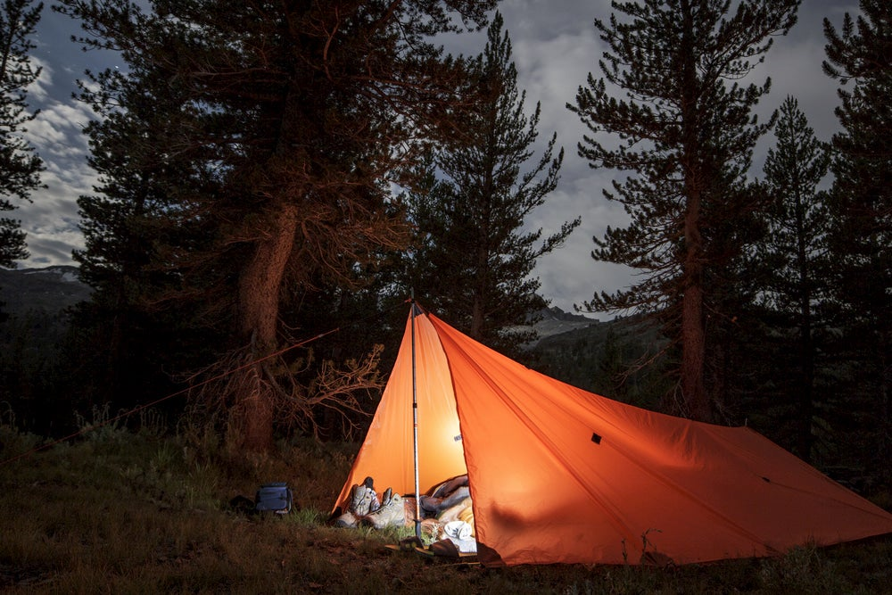 How to Camp With a Tarp Instead of a Tent This Summer