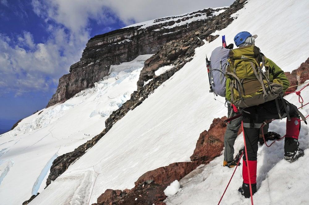 a man climbs mount rainier