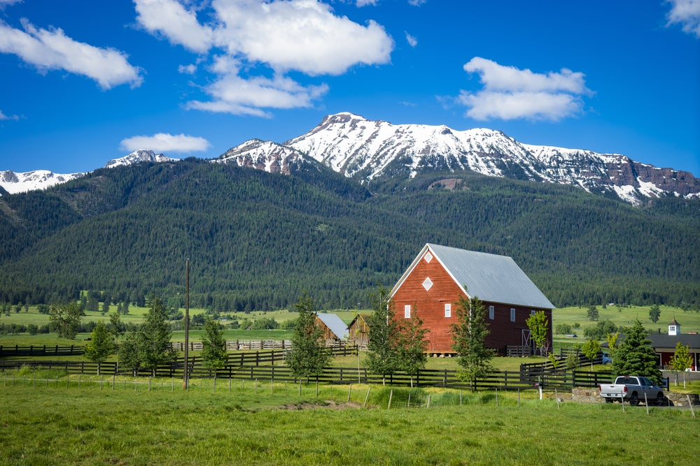 Wallowa mountains with red barn in foreground