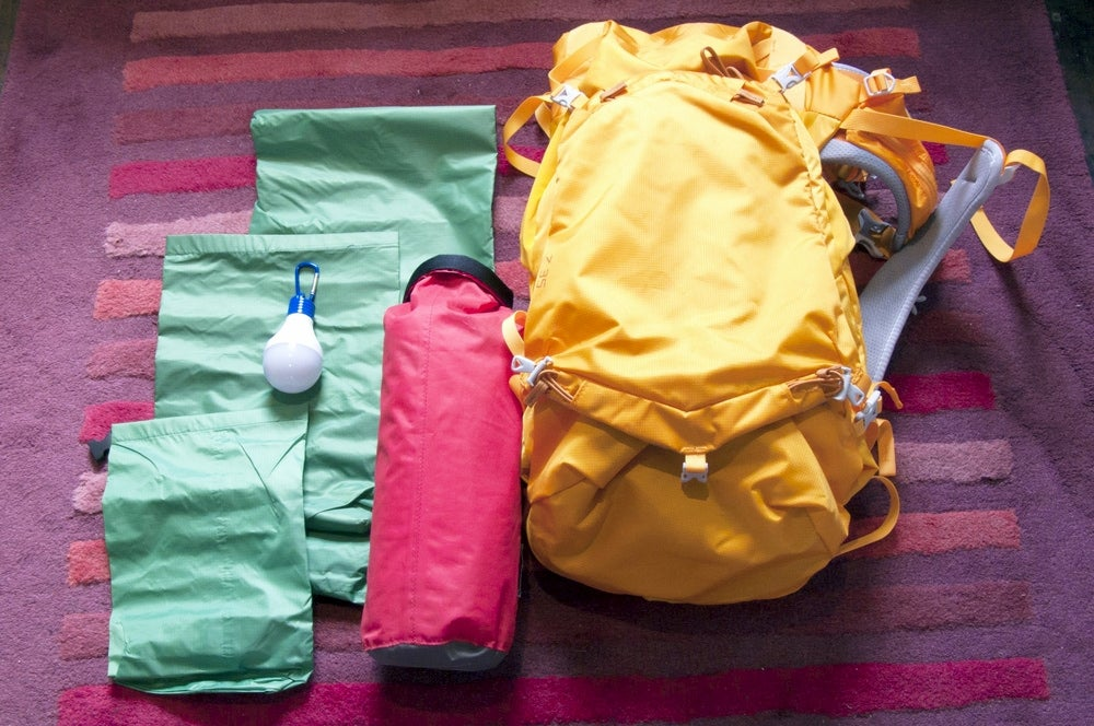 Backpacking gear with three excess stuff sacks.