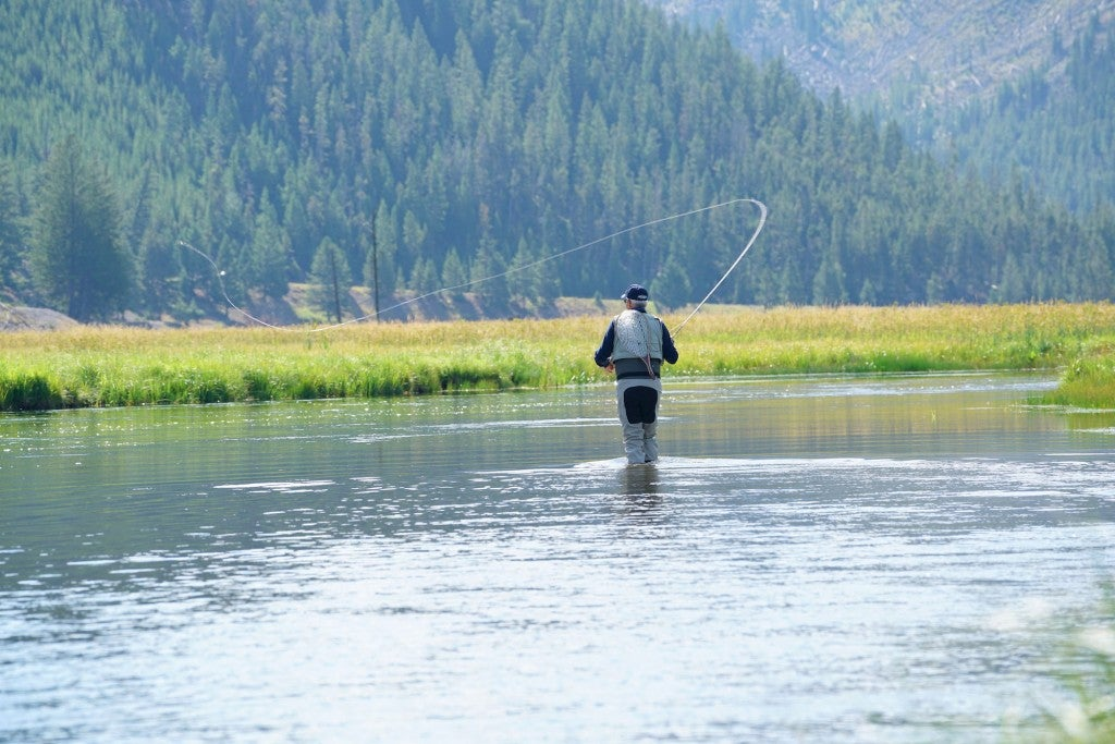 Man fly fishing on river in Wyoming