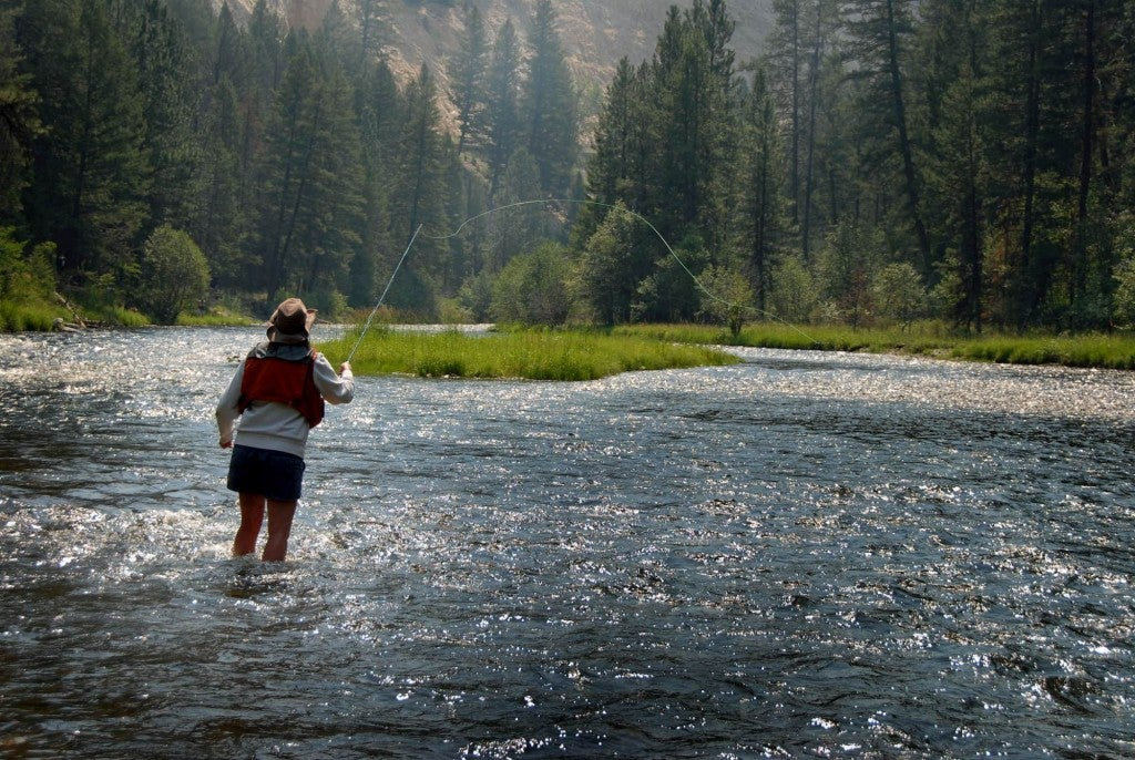 Woman fly fishing in Montana river