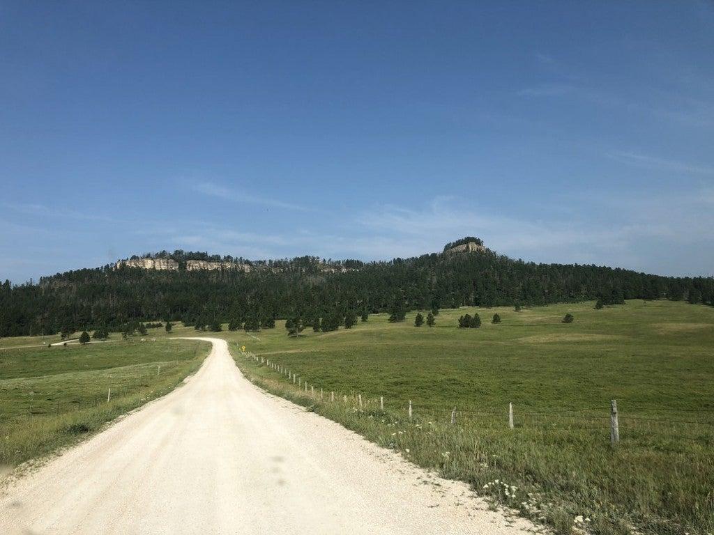 a dirt road trailing to the black hills of south dakota