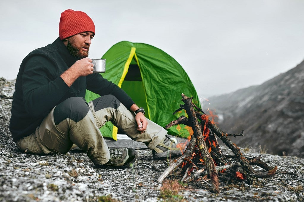 man camping in wilderness