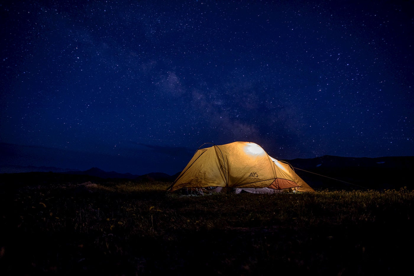 Tent lit up at night.
