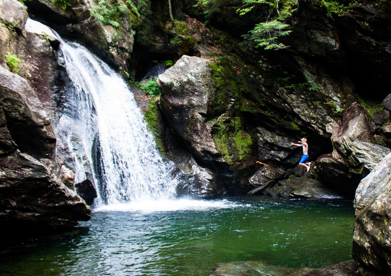 Swimming jumping off a cliff at Bingham Falls.