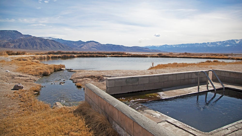 a concrete hot spring at the start of a river in nevada