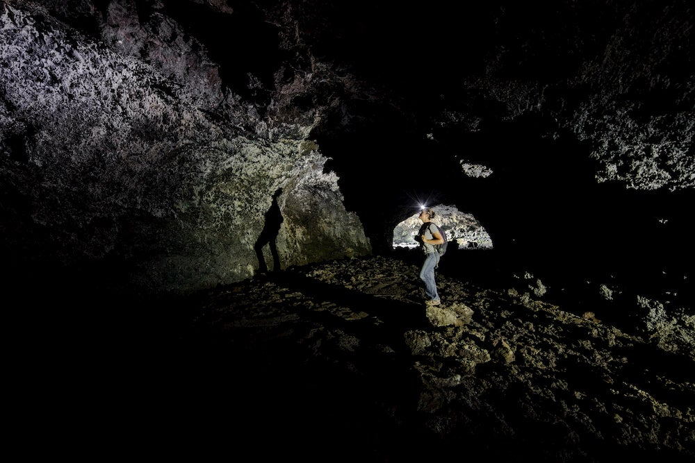 A caver explores the inside of Beauty Cave.