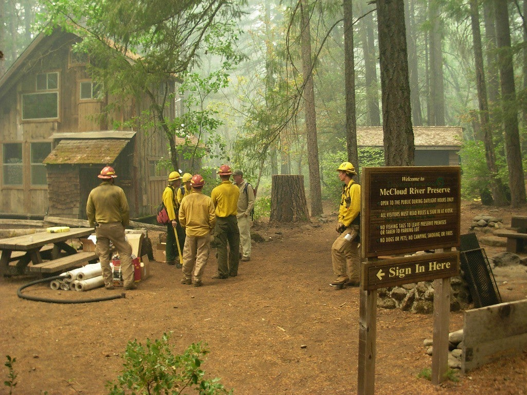 A Nature Conservancy fire crew stationed at the McCloud River Preserve helps protect structures from fire damage. Image from George Stroud, The Nature Conservancy