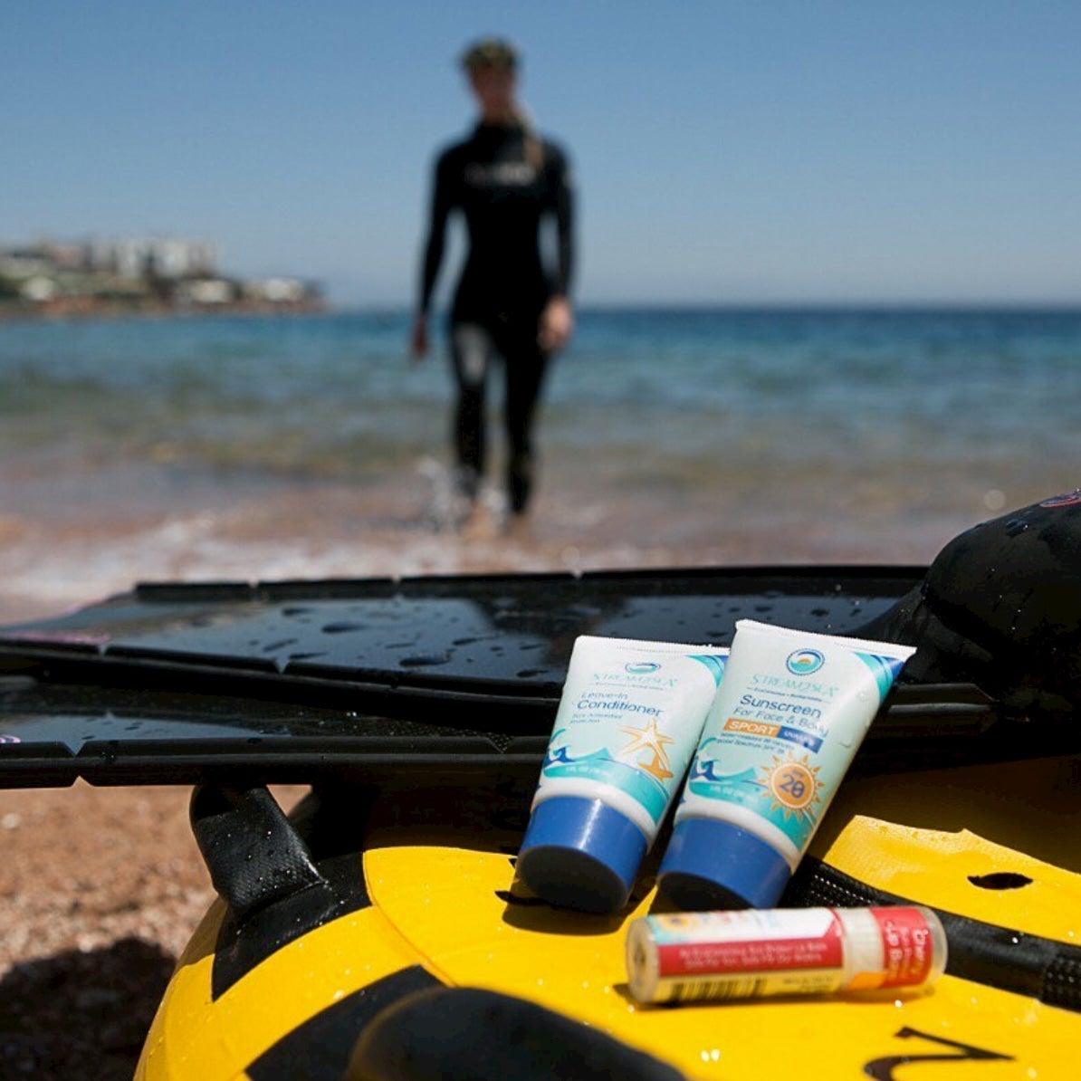 Stream2Sea sunscreen on a raft on a beach.
