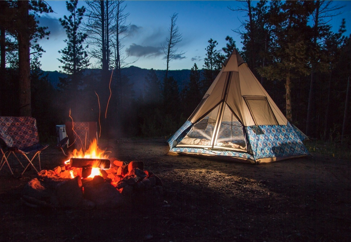 Wenzel tent beside campfire in the backcountry.
